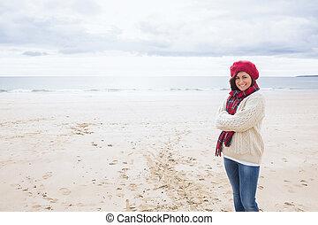 Portrait of a pretty woman in stylish warm wear at beach -...