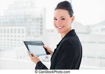 Close-up of an elegant businesswoman with tablet PC