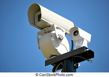 Security Camera - Security camera isolated over the sky