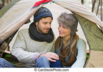 Young couple camping in the wilderness - Loving couple...