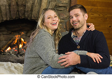 Romantic couple in front of lit