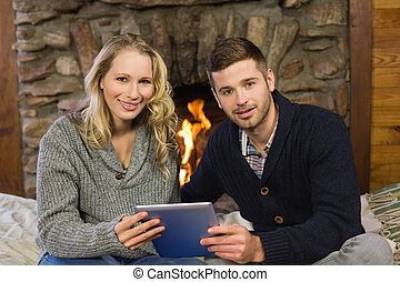 Lovely couple using tablet PC in - Portrait of a lovely...