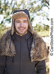 Smiling man in warm clothing - Portrait of a smiling young...