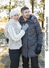 Loving young couple in winter cloth - Loving young couple...