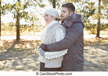 Loving young couple in winter cloth - Side view of a loving...
