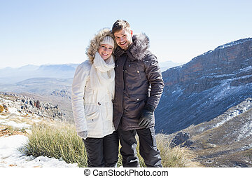 Smiling couple in fur hood jackets