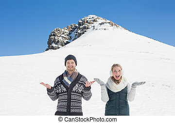 Happy couple in warm clothing in fr - Portrait of a happy...