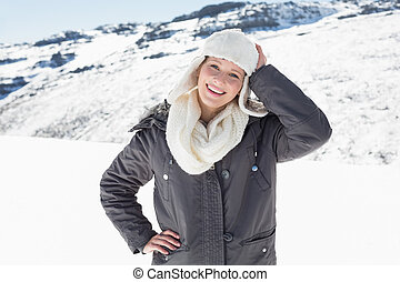 Woman in warm clothing on snowed - Portrait of a smiling...