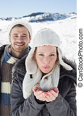 Couple with cupped hands on snowed landscape - Portrait of a...