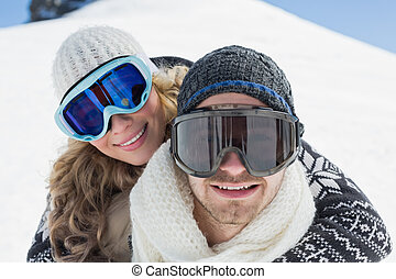 Close-up of a couple in ski goggles against snow - Close-up...