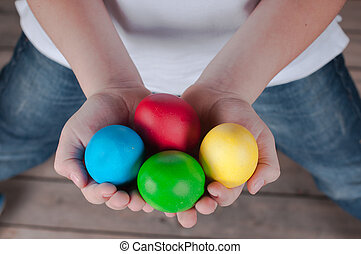 Easter eggs hunt - Boy is holding Easter egs in his  hands