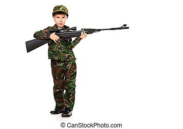 military kid - A boy dressed like a soldier standing with a...