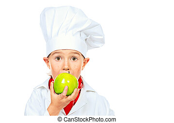healthy eating - Little boy cook eating green apple...