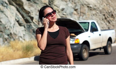 Stranded Woman Cellular Call - Hispanic woman with her truck...