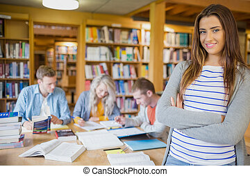 Female student with others in background at library -...
