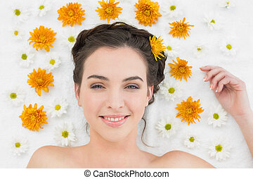 Beautiful young woman with flowers in beauty salon - Close...
