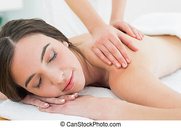 Beautiful woman enjoying back massage at beauty spa - Close...