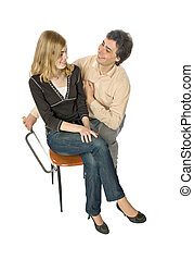 Treachery - Man flirting with a woman sawing her chair leg