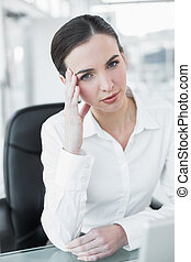 Worried businesswoman with laptop at office - Portrait of a...
