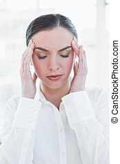 Close up of businesswoman suffering from headache - Close up...