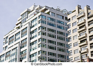 Urban Condo Tower - A large terraced condominium tower with...