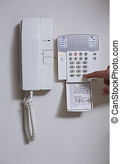Close up of wall phone and list of numbers