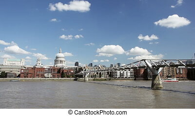 Millennium Bridge and St. Paul's - People crossing the...