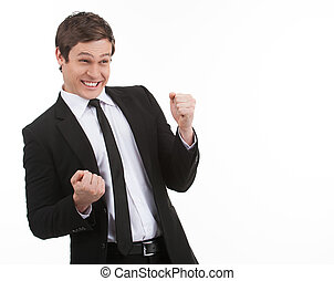 Yes! Happy young businessman gesturing while isolated on...