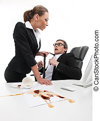 What are you doing? Stressed young businessman looking at his secretary holding his necktie