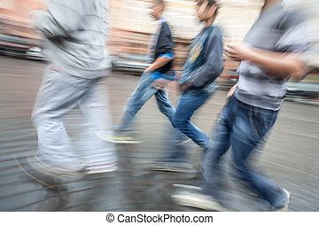 Group of young people hurrying about their business...
