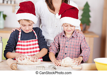 Two little boys learning to bake Xmas cookies - Two little...