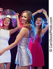 "three smiling women dancing in the club - party, ""new year"",..."