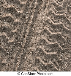Dusty Contry Road With Tire Tracks - Photograph of a tire...