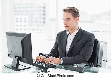Businessman using computer at office desk
