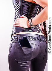 Cell phone in back pocket - close up of cell phone in girls...