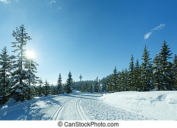 Winter sunny mountain landscape with ski run. - Winter sunny...