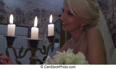 Young bride by candlelight in cafe