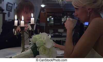 Wedding couple in cafe
