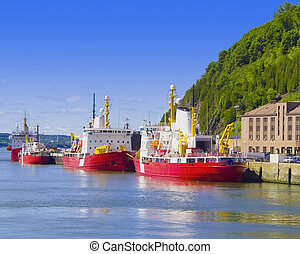 Cargo Boats - Cargo boats line up a a dock on the St....
