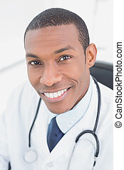Close up portrait of a smiling male doctor