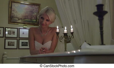 Wedding couple at the piano by candlelight,  tracking shot