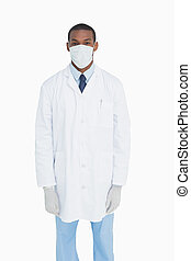 Portrait of male doctor wearing mask and gloves - Portrait...