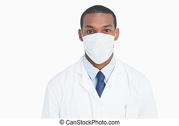 Close up portrait of a male doctor wearing mask against...