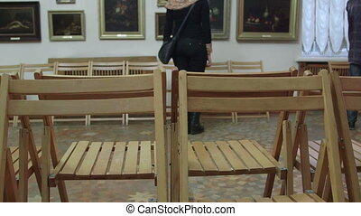 DOLLY: Visit Art Gallery - Visitors looking at paintings in...