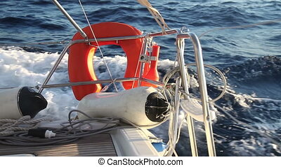 Lifebuoy on the yacht racing in sea - Lifebuoy on the yacht...