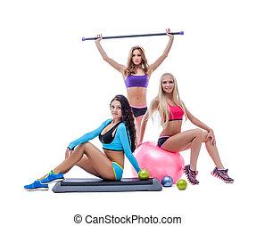 Beautiful slender sportswomen isolated on white background