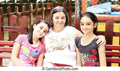 Senior woman with granddaughters
