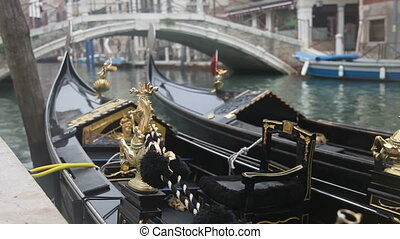 Gondola in Venice at the pier closeup view of figurine