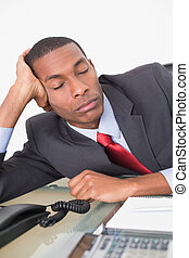 Afro businessman resting at desk over white background -...