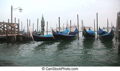 Gondolas in Venice at the pier and view San Giorgio Maggiore...